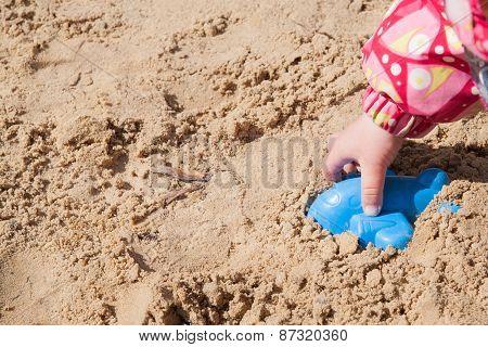 Children's Hand In The Sandbox