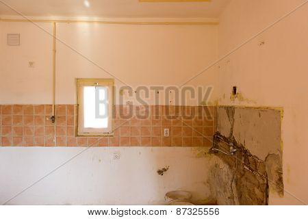 Empty abandoned old kitchen