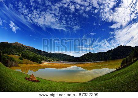 red polluted lake in Romania, Alba, Geamana