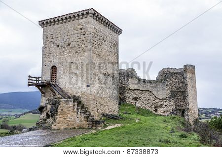 Castle Of Santa Gadea Del Cid With A Dark Sky In Burgos
