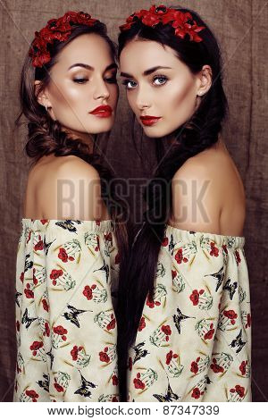 Beautiful Girls With Dark Hair In Dresses With Prints Of Red Poppies