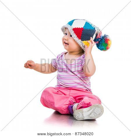 happy cute one year-old girl  in the cap on a white ackground