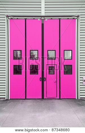 Pink Garage Door on a warehouse building