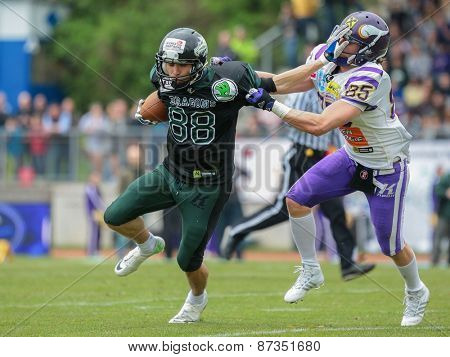 VIENNA, AUSTRIA - APRIL 13, 2014: WR Johannes Prammer (#88 Dragons) is tackled by DB Valentin Schulz (#85 Vikings).