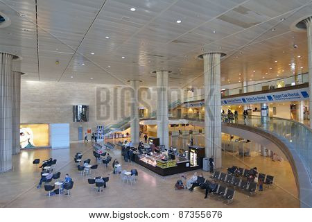 TEL AVIV, ISRAEL - MARCH 21, 2014: Passengers waiting for flights in the Ben Gurion International airport. In 2013, the airport handled 14,227,612 passengers