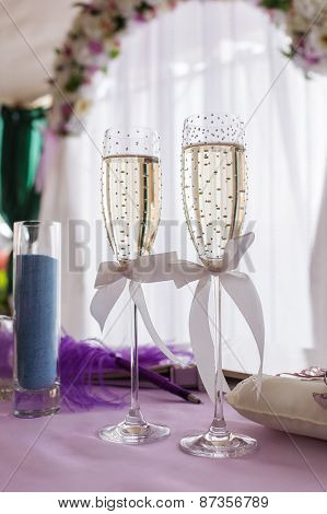 wedding glasses of champagne decorated with strass and ribbon bows