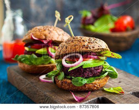 Veggie beet and quinoa burger with avocado poster