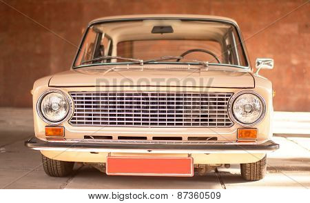 Beige old russian restored car front view poster