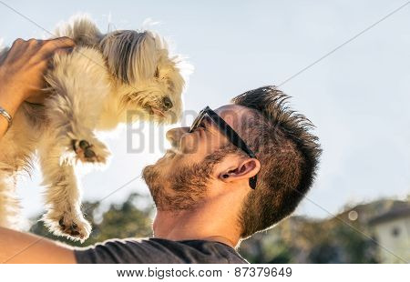 Cool Dog Playing With His Owner