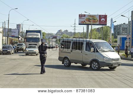Police road service regulate traffic with a rod