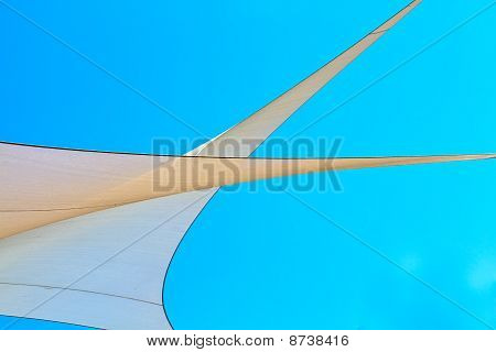 Canvas sails against bright blue sky