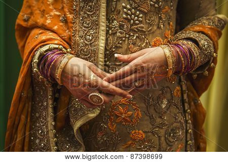 Indian bride with jewelry and henna