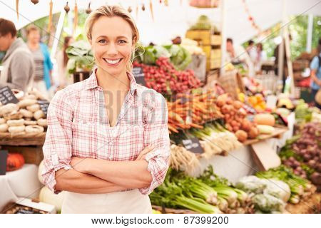 Female Stall Holder At Farmers Fresh Food Market