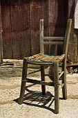 Old chair in front of a house Taken on Thasos Island Greece. poster