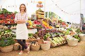 Female Stall Holder At Farmers Fresh Food Market poster
