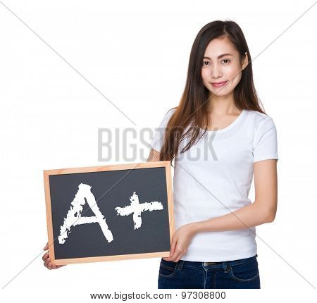 Young lady hold with blackboard showing mark A plus