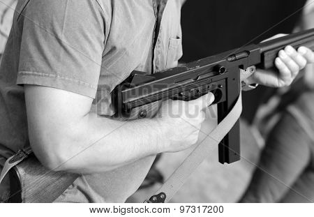 Soldier In Uniform With A Submachine Gun In His Hand