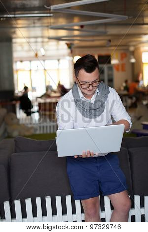 Stylish Man Using Laptop In Startup Office