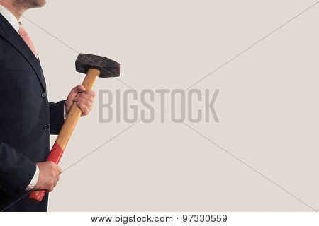 Businessman Holding A Sledgehammer In His Hands