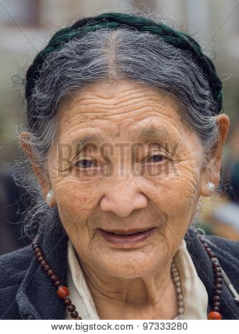 Old Tibetan Buddhist Woman In The Dharamsala, India