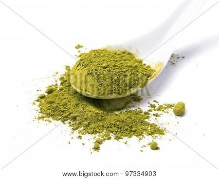 Matcha Powder Tea In A Spoon Isolated On White Background