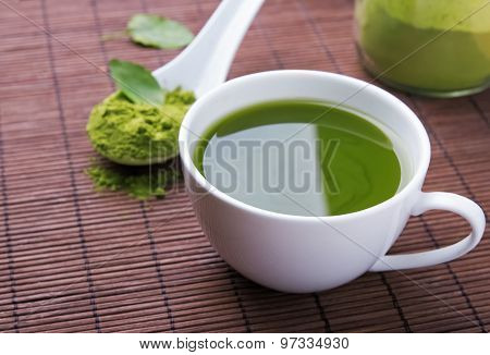 Green Tea Matcha In A Cup On The Brown Mat