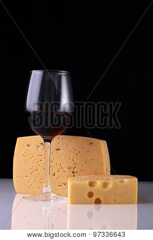 Two Kinds Of Cheese And Glass Of Wine