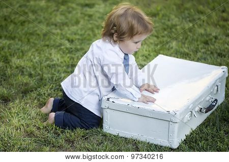 Small Baby Boy With Vintage Briefcase