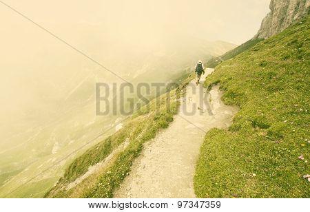 Man trekking in high mountains