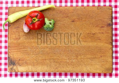 Cutting board and vegetales on board