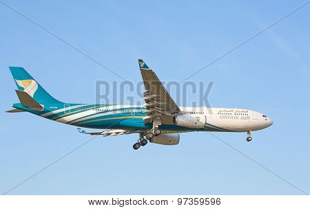 ZURICH - JULY 18: Airbus A-330 Oman Air landing in Zurich after short haul flight on July 18, 2015 in Zurich, Switzerland. Zurich airport is home for Swiss Air and one of biggest european hubs.