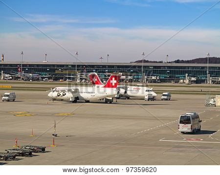 ZURICH - JULY 18: AVRO RJ100 in Zurich airport after short haul flight on July 18, 2015 in Zurich, Switzerland. Zurich airport is home for Swiss Air and one of the biggest european hubs.
