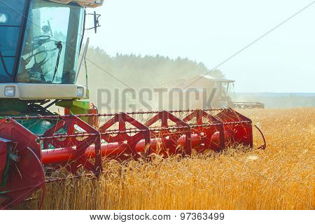 combine harvester working on a wheat field poster