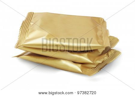 Stack of Candy in Sealed Golden Colour Wrappers on White Background