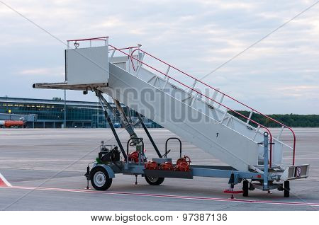 The image of a movable boarding ramp at the airport