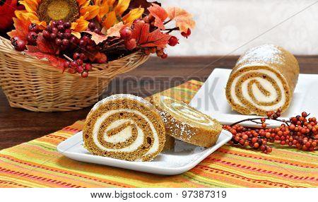Pumpkin Roll Cake In An Autumn Setting.