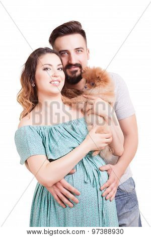Pregnant Woamn With Dog In Hands And Husband Beside Her
