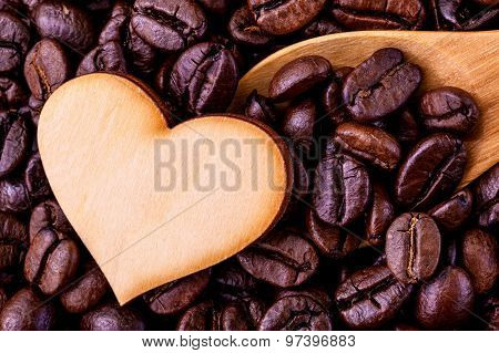 Coffee Beans With Wooden Shape Of Heart. - Concept For Love Coffee.
