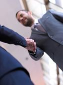 business partners, partnership concept with two businessman handshake poster