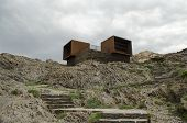Symbolic cabins of a former holiday resort in Cap de Creus (Catalonia), which has been recently removed in order to restore this natural park. poster