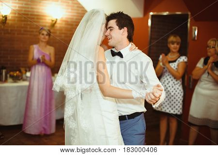 Husband is dancing with his wife on the wedding