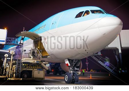 Maintenance Of A Large Airplane In The Parking Lot At The Airport At Night