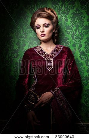 Portrait of beautiful woman with perfect make up on vintage background in retro and interior. Rococo period. Luxury and high class