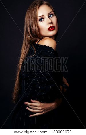 Studio Photo Of Young  Woman On Black Background .
