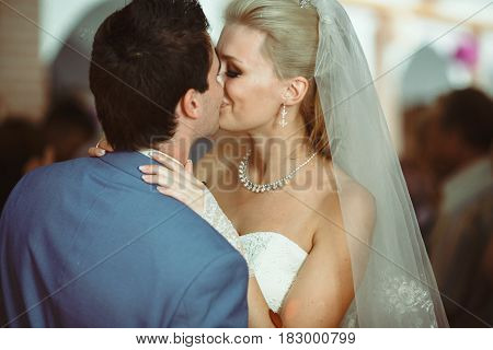 Lovely Kiss During The First Dance On The Wedding