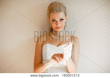 Charming glance of the blonde bride before the wedding