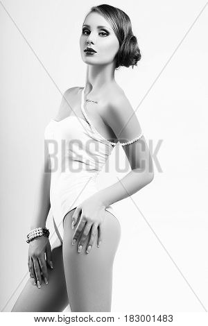 Studio Photo Of Young  Woman On White Background. Black And White.