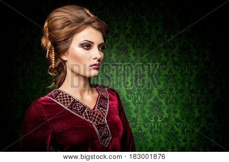 Attractive woman dressed vintage clothes in retro interior. Rococo period. Luxury and high class