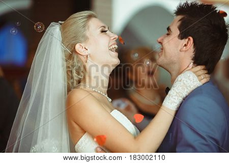 Joyful Couple During The First Dance On The Wedding