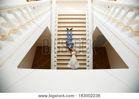 Couple Lies On The Stairs In The Wedding Day